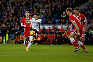 Tom Lawrence of Rotherham (c) shoots at goal. Skybet football league championship match, Cardiff city v Rotherham Utd at the Cardiff city stadium in Cardiff, South Wales on Saturday 6th December 2014<br /> pic by Mark Hawkins, Andrew Orchard sports photography.