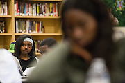 Hoover Middle School 8th grader Raeesa Earnest listens to a guest speaker during the Black Student Union seminar at Milpitas High School in Milpitas, California, on February 27, 2016. (Stan Olszewski/SOSKIphoto)