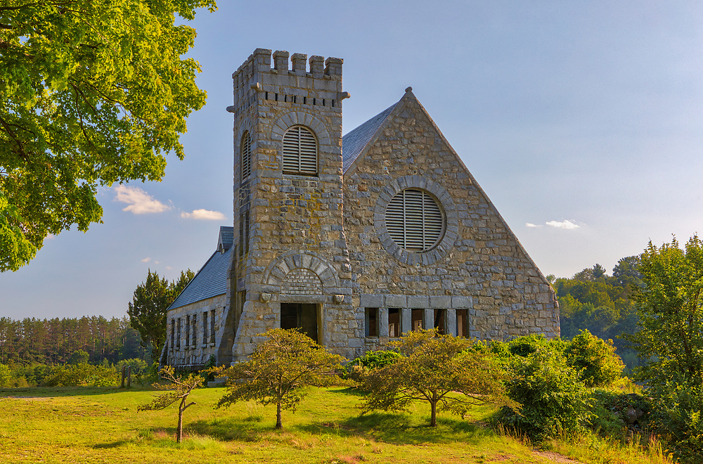 New England landmark photography scenery of the iconic Old Stone Church in West Boylston at the banks of the Wachusett Reservoir, Massachusetts.