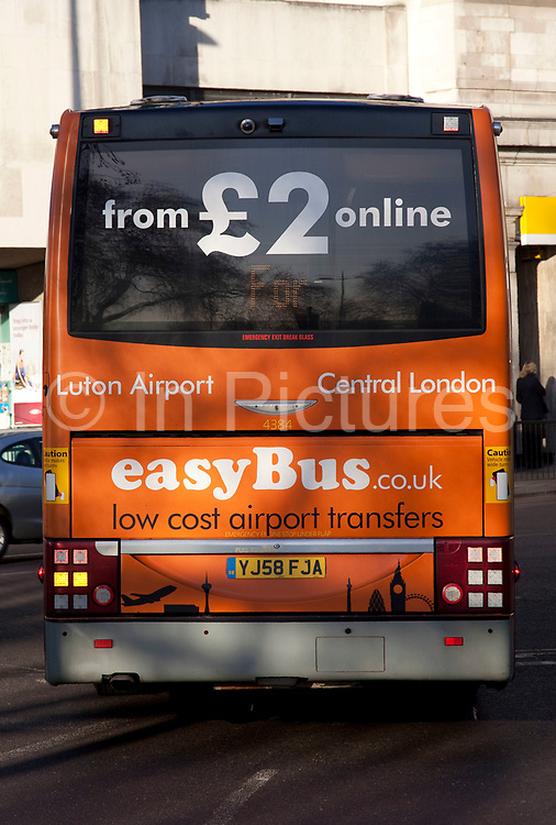 Rear of an Easyjet Easybus bus, used for cheap transfer to flights for the low cost airline.