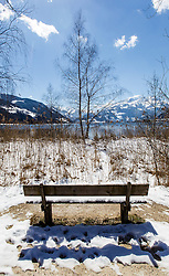 THEMENBILD - eine Parkbank an der Uferpromenade des Zeller Sees, aufgenommen am 03. April 2015, am Zeller See, Zell am See, Oesterreich // a park bench on the promenade of Lake Zell, Zell am See, Austria on 2015/04/03. EXPA Pictures © 2015, PhotoCredit: EXPA/ JFK