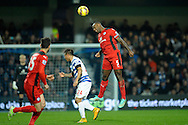Wes Morgan, the Leicester City Capt heading the ball . Barclays Premier league match, Queens Park Rangers v Leicester city at Loftus Road in London on Saturday 29th November 2014.<br /> pic by John Patrick Fletcher, Andrew Orchard sports photography.
