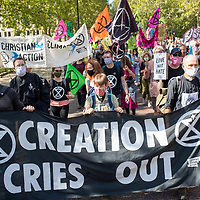 A ecumenical group from Christian Climate Action at the beginning of a march urging government to take urgent action on climate change. The group includes Rev. Hilary Bond, Rev Jonathan Herbert and Fr Martin Newell. Members of the group were arrested later during the demonstration.