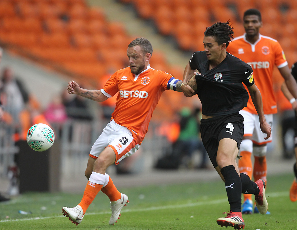 Blackpool's Jay Spearing  battles with Barnsley's Kenny Dougall <br /> <br /> Photographer Mick Walker/CameraSport<br /> <br /> Carabao Cup First Round - Blackpool v Barnsley - Tuesday August 14th 2018 - Bloomfield Road - Blackpool<br />  <br /> World Copyright © 2018 CameraSport. All rights reserved. 43 Linden Ave. Countesthorpe. Leicester. England. LE8 5PG - Tel: +44 (0) 116 277 4147 - admin@camerasport.com - www.camerasport.com