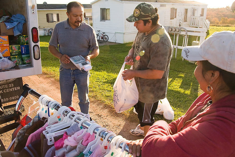 A traveling salesman sells Mexican food products, clothing and other items from his truck to residents at Hudson Valley Foie Gras in Ferndale, New York on October 11, 2008. Some of the workers and their families, practically all Mexican immigrants, live on the grounds of the factory in company provided housing; a small, isolated Mexican community flourishes in the Catskills.