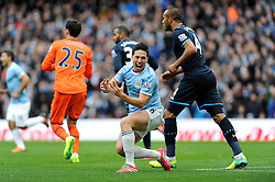 Manchester City's Samir Nasri cuts a frustrated figure after being tackled in the penalty area by Tottenham Hotspur's Sandro - Photo mandatory by-line: Dougie Allward/JMP - Tel: Mobile: 07966 386802 24/11/2013 - SPORT - Football - Manchester - Etihad Stadium - Manchester City v Tottenham Hotspur - Barclays Premier League