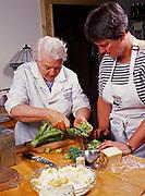 Madeleine Kamman and Patty Park preparing broccoli, cooking seminar at Kirsten and Carl Dixon's Winterlake Lodge, Alaska.  (Model Released)