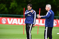 Chris Coleman, the Wales manager has a laugh during Wales football team training at the Vale Resort, Hensol near Cardiff, South Wales on Monday 8th June 2015. The Wales team are preparing for their forthcoming Euro 2016 qualifying match against Belgium.<br /> pic by Andrew Orchard, Andrew Orchard sports photography.