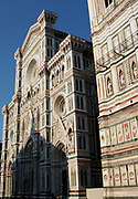 The Basilica di Santa Maria del Fiore (English: Basilica of Saint Mary of the Flower) is the cathedral church of Florence, Italy. The Duomo, as it is ordinarily called, was begun in 1296 in the Gothic style to the design of Arnolfo di Cambio and completed structurally in 1436 with the dome engineered by Filippo Brunelleschi. The exterior of the basilica is faced with polychrome marble panels in various shades of green and pink bordered by white and has an elaborate 19th century Gothic Revival façade by Emilio De Fabris. The cathedral complex, located in Piazza del Duomo, includes the Baptistery and Giotto's Campanile