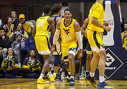 Dec 8, 2018; Morgantown, WV, USA; West Virginia Mountaineers forward Sagaba Konate (50) celebrates during the first half against the Pittsburgh Panthers at WVU Coliseum. Mandatory Credit: Ben Queen-USA TODAY Sports