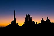 Sunrise at Totem Pole and Yei Bi Chei rock formations, Monument Valley Navajo Tribal Park, Kayenta, Arizona