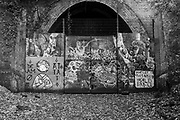 Graffiti covers the closed tunnel that was once part of the Nunhead to Crystal Palace (High Level) railway which once passed through Sydenham Hill Woods. The track bed can be followed to a disused and closed tunnel which is now a registered bat roost, on 25th October 2020, in London, England.