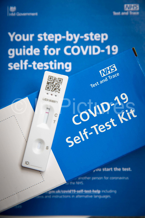 A negative result on a COVID-19 Lateral Flow test strip, Lateral Flow Device LFD kits were given to all secondary school pupils in England so they can test themselves twice a week at home on the 21st March 2021 in Folkestone, United Kingdom.