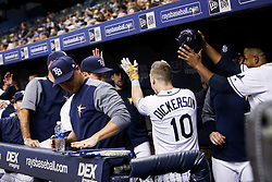 August 22, 2017 - St. Petersburg, Florida, U.S. - WILL VRAGOVIC   |   Times.Tampa Bay Rays left fielder Corey Dickerson (10) collects high fives in the dugout after his solo home run in the second inning of the game between the Toronto Blue Jays and the Tampa Bay Rays at Tropicana Field in St. Petersburg, Fla. on Tuesday, Aug. 22, 2017. (Credit Image: © Will Vragovic/Tampa Bay Times via ZUMA Wire)