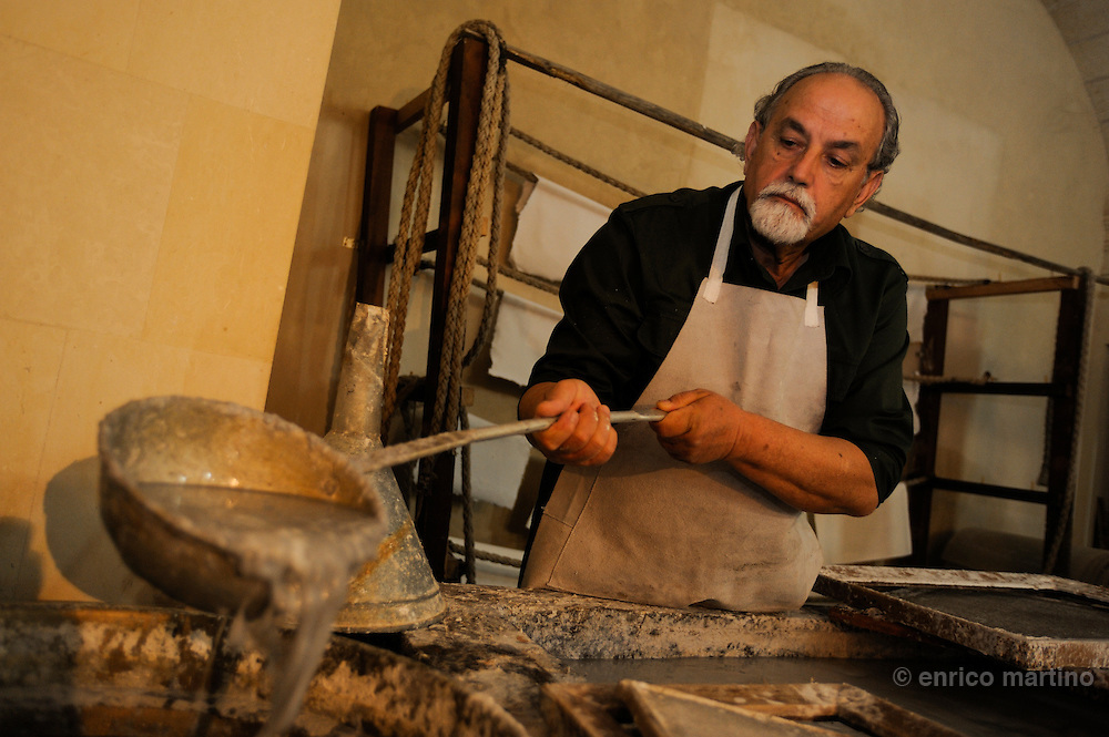 """Martano, a small town around Lecce. Luigi Baldari, famous craftsman of the papier-mâché. With the """"focheggiatura"""" the papier-mâché is worked with red-hot tools to mould to the due form. The papier-mâché is obtained in a traditional way, like in Middle Age. The papier-mâché, a pulp of paper and old rags with cellulose, water and paste is boiled and pressed with animals glue and resin size to obtain a dense  pulp."""