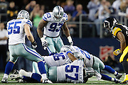 A gang of Cowboys sack Pittsburgh Steelers quarterback Ben Roethlisberger (7) at Cowboys Stadium in Arlington, Texas, on December 16, 2012.  (Stan Olszewski/The Dallas Morning News)