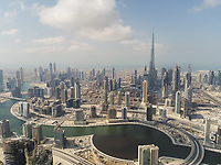 Aerial view of Burj Khalifa Tower, skyscrapers and canal in Dubai, United Arab Emirates.