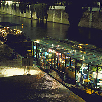 Jazz Boat Restaurants at night docked along the Seine across from the ile de Le Cite and Notre Dame in Paris