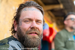 Tattoo artist Justin Big Meas Wilson in Motorcycle Sherpa's Ride to the Heavens motorcycle adventure in the Himalayas of Nepal. This first day of riding took us from Kathmandu to Nuwakot. Monday, November 4, 2019. Photography ©2019 Michael Lichter.