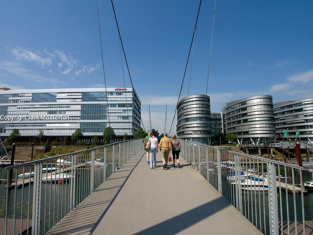 Modern footbridge and office buildings at Innenhafen area of Duisburg in North Rhine-Westphalia Germany