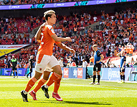 Blackpool's Kenny Dougall celebrates scoring his side's first goal with team mate Keshi Anderson <br /> <br /> Photographer Andrew Kearns/CameraSport<br /> <br /> The EFL Sky Bet League One Play-Off Final - Blackpool v Lincoln City - Sunday 30th May 2021 - Wembley Stadium - London<br /> <br /> World Copyright © 2021 CameraSport. All rights reserved. 43 Linden Ave. Countesthorpe. Leicester. England. LE8 5PG - Tel: +44 (0) 116 277 4147 - admin@camerasport.com - www.camerasport.com