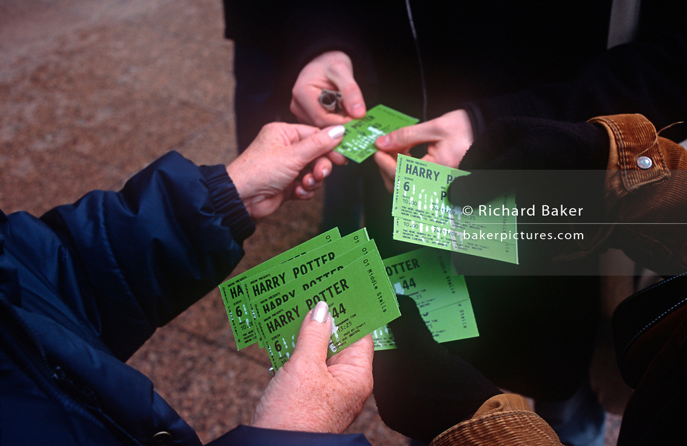 Recently-purchased tickets for the new Harry Potter film, Chamber of Secrets from the original book by KJ Rowling, are handed out to family members in Leicester Square, on 24th November 2002, in London, England. (Photo by Richard Baker / In Pictures via Getty Images)