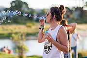 Bubbles Festival in Kuaotunu at the reserve . Adults  drink bubbles children blow bubbles. Coromandel Photographer Felicity Jean Photography stock photos new zealand, new zealand stock imagery, kiwiana photos, new zealand landscapes, coromandel photos, travel photos, tourism photos, adventure photography, stock photos coromandel