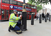under license to London News Pictures. LONDON, UK  17/05/2011. A police officer checks a lamp post outside Downing Street before placing a security seal on it. Police carry out security checks in Whitehall, Central London today (17 May 2011). Please see special instructions for usage rates. Photo credit should read Stephen Simpson/LNP.