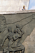 Young women sat by the memorial, Monument to the Conquerors of Space, Moscow, Russia