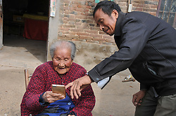 October 8, 2016 - Anyang, Anyang, China - Anyang, CHINA-October 8 2016: (EDITORIAL USE ONLY. CHINA OUT) Ma Chunhuan, a 103-year-old woman, uses cell phone in Siyangzhuang Village, Neihuang County, Anyang, central China¡¯s Henan Province, October 8th, 2016. Although Ma Chunhuan is 103 years old, she can do needle work flexibly and use cell phone easily. (Credit Image: © SIPA Asia via ZUMA Wire)