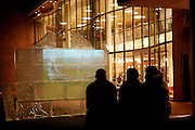 Students huddle for warmth outside the JRC watching a slideshow composed of climate-related images on Wednesday night.