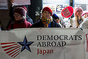 Women take part in a protest march by members of the Democratic Party Abroad organisation to mark the inauguration of President Donald Trump, Tokyo, Japan. Friday January 20th 2017 Around 400 people took apart in the march, which started in Hibiya Park at 6:30pm and finished in Roppongi just before 8pm, to honour the service given by President Obama and to protest against the illiberal policies expected of the new administration of President  Trump.