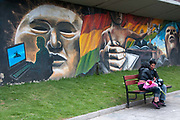 Bolivia June 2013. La Paz. Wall painting showing modern Bolivia with courting couple.