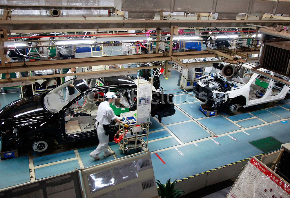 A workers operates on the assembly line of the Guangzhou Automobile Group Co. (GAC) Toyota Motor Co. Ltd., factory in Guangzhou, Guandong Province, China, on Monday, Nov. 14, 2011. Toyota plans to invest an additional $689 million in a research and development venture in China aiming to expand in the world's largest car market.