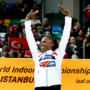 Gold medal winner Chaunte Lowe form the United States listens to the anthem during the IAAF World Indoor Championships at the Atakoy Athletics Arena, Istanbul, Turkey. Photo by TURKPIX