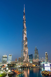 Dusk view of Burj Khalifa tower with spectacular LED light effects on facade in Dubai United Arab Emirates