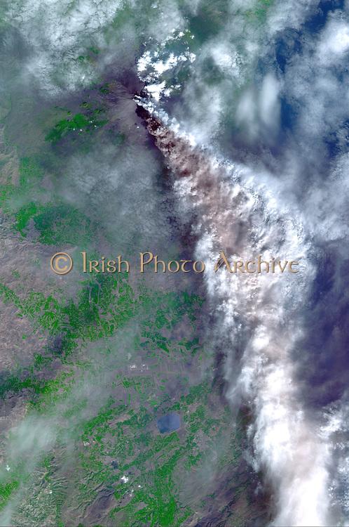 November 3, 2002, Mt. Etna's ash-laden plume. Satellite image.