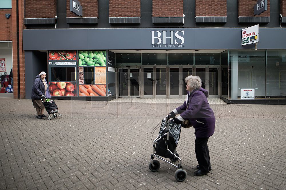 © Licensed to London News Pictures . 03/02/2017. Stoke-on-Trent, UK . People pass a closed down branch of BHS in Hanley town centre in the constituency of Stoke-on-Trent Central . The by-election in the constituency is due to take place on 23rd February . Photo credit: Joel Goodman/LNP