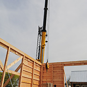 After all walls are in place a corner weight is lowered into position.