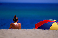 sunbather and parasol, Tahiti Beach, St. Tropez, France - Photograph by Owen Franken - Photograph by Owen Franken