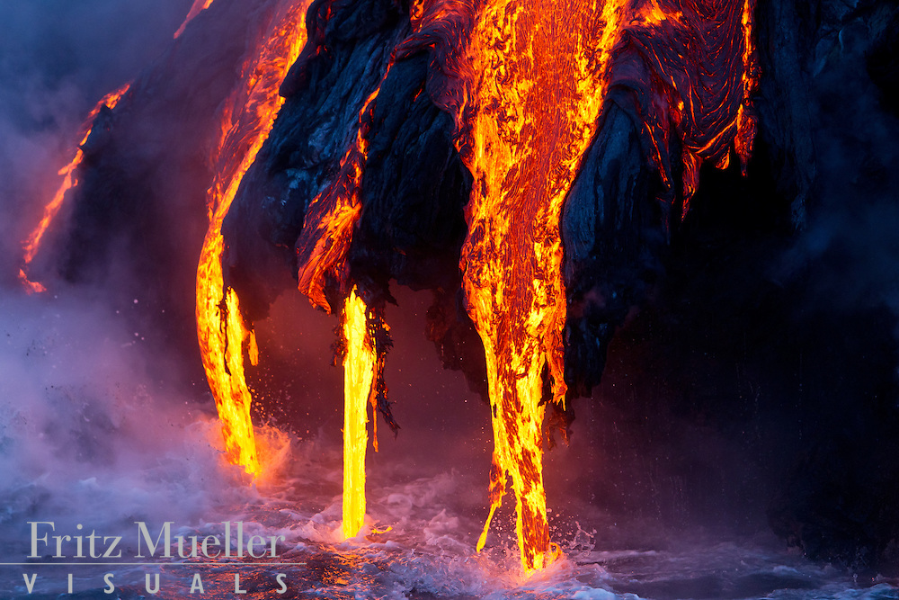 Lava flows into the Pacafic Ocean on the Puna Coast, Volcanoes National Park, Hawaii