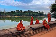 Pilgrim monks relaxing around the moat of Angkor Wat.