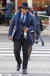 © Licensed to London News Pictures. 23/02/2018. London, UK. Lanre Haastrup, father of 11-month-old Isaiah Haastrup, arrives at the High Court in London. Judges are set to rule on whether doctors at King's College Hospital can withdraw life support for Isaiah who suffered severe brain damage. Photo credit: Rob Pinney/LNP