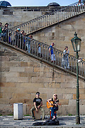Street musicians playing at Kampa Island underneath Charles Bridge.