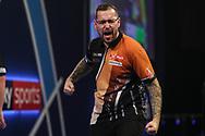 Benito van de Pas wins set and celebrates during the World Darts Championships 2018 at Alexandra Palace, London, United Kingdom on 27 December 2018.