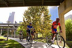 Group of cyclists on the bike path running through Buffalo Bayou park in Houston, Texas