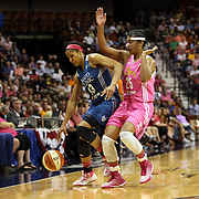 Maya Moore, (left), Minnesota Lynx, defended by Alyssa Thomas, Connecticut Sun, in action during the Connecticut Sun Vs Minnesota Lynx, WNBA regular season game at Mohegan Sun Arena, Uncasville, Connecticut, USA. 27th July 2014. Photo Tim Clayton