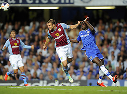 "Aston Villa's Ron Vlaar battles for the high ball with Chelsea's Demba Ba  - Photo mandatory by-line: Joe Meredith/JMP - Tel: Mobile: 07966 386802 21/08/2013 - SPORT - FOOTBALL - Stamford Bridge - London - Chelsea V Aston Villa - Barclays Premier League - EDITORIAL USE ONLY. No use with unauthorised audio, video, data, fixture lists, club/league logos or ""live"" services. Online in-match use limited to 45 images, no video emulation. No use in betting, games or single club/league/player publications"