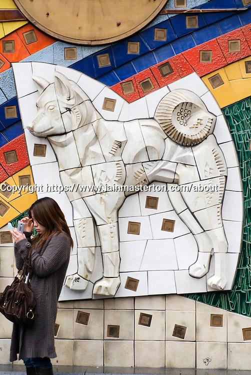 Ceramic tile mosaic of Hatchiko the Dog at Shibuya railway station in central Tokyo Japan