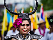 04 OCTOBER 2017 - CHONBURI, CHONBURI, THAILAND: A woman wearing a water buffalo hat in the parade before the races. Contestants race water buffalo about 100 meters down a muddy straight away. The buffalo races in Chonburi first took place in 1912 for Thai King Rama VI. Now the races have evolved into a festival that marks the end of Buddhist Lent and is held on the first full moon of the 11th lunar month (either October or November). Thousands of people come to Chonburi, about 90 minutes from Bangkok, for the races and carnival midway.   PHOTO BY JACK KURTZ